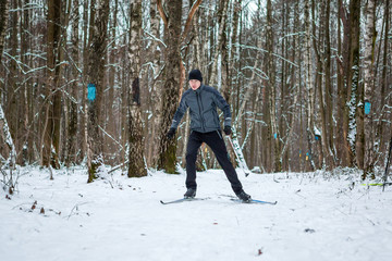 Photo of male skier in gray jacket