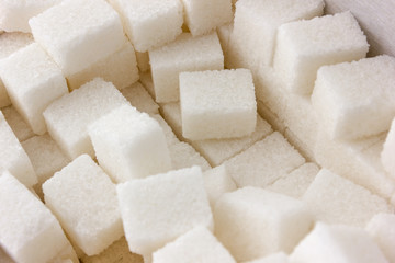 Cubes of sugar on a white background. Many cubes of sugar close-up.