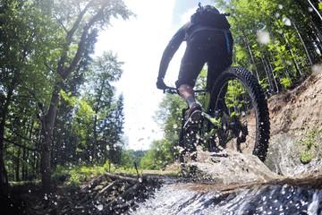 Mountain biker creates a splash of water