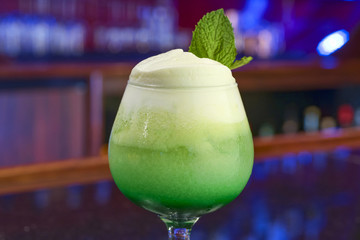 Green cocktail with mint leaf