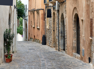 Fototapeta Empty cobblestone street of old town of Ibiza. Spain