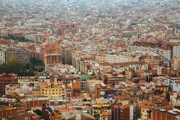 Aerial view of Barcelona city in Spain with nature around it.