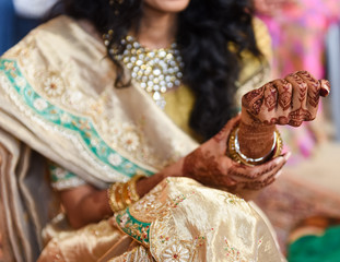 close up of Indian / Hindu bride wearing henna and bracelets