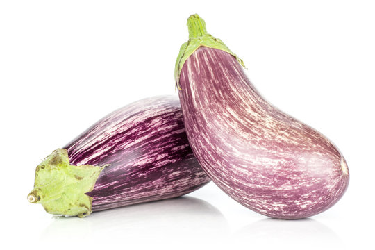 Two striped purple eggplants isolated on white background.