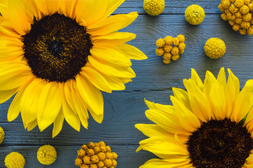 Yellow Flowers on Blue Table