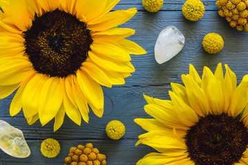 Yellow Flowers and Citrine on Blue Table