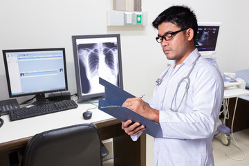 Doctor recording patient history in laboratory