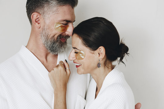 Couple relaxing with golden eye mask treatment