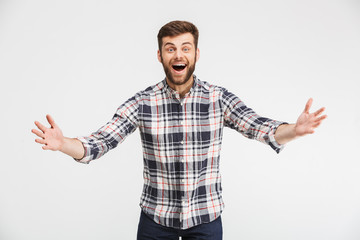 Portrait of an excited young man celebrating