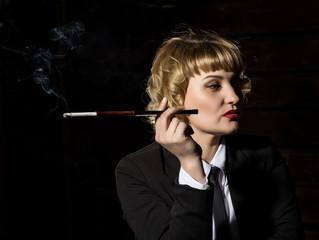 businesswoman with cigarette on a dark background, stylized retro portrait
