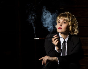 businesswoman with cigarette on a dark background, stylized retro portrait. free space for text