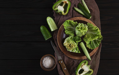cabbage, green vegetables on a wooden table, Bulgarian green pepper, lettuce, cucumber, diet and detox