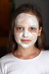 girl with white cosmetic mask on face