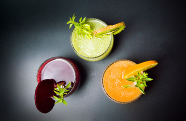 Various fruit smoothies in glasses