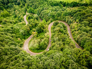 Aerial view of an extreme winding road up in the mountains