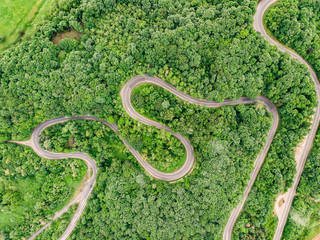 Roads from above extreme winding road in the mountains aerial view