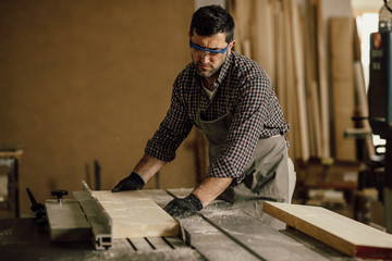 Professional carpenter at work in his laboratory