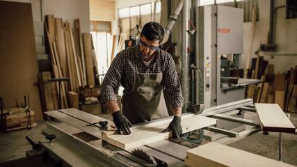 Fototapeta Skilled Carpenter craftsman at work in his workshop obraz