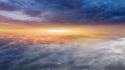 Light from the sun shining through the clouds in the sky . Dramatic nature background .  Sunset or sunrise with clouds, light rays and other atmospheric effect  . Religion background .