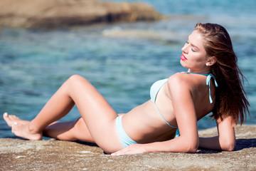 Beautiful woman in a bikini on the beach vacation