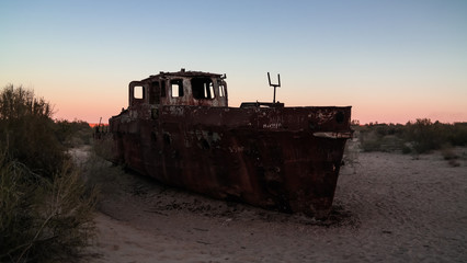 Panorama of ship cemetery at sunset near Moynaq, Karakalpakstan, Uzbekistan