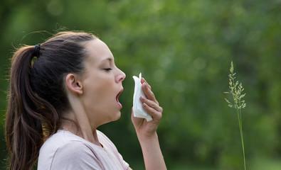 Girl having allergy reaction in park