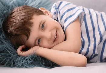 Cute little boy lying on sofa, closeup
