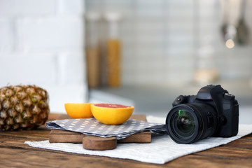 Professional camera and fruits on table. Food blog