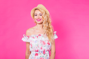 Fashion photo of a beautiful elegant young woman in a pretty dress posing over pink background. Fashion spring summer photo