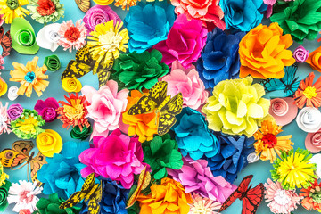 Bright paper artificial flowers as a background