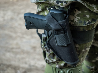 A pistol in the holster of a military officer, a special police officer, a policeman