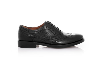 Close up of a black mens brogues shoes on white background with reflection. Fashion advertising shoes photos.