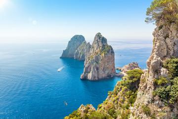 Tuinposter Blauwe hemel Famous Faraglioni rocks from Capri island, Italy