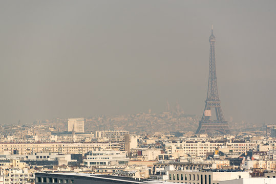 Aerial view of the Eiffel tower in the fog in Paris. City air pollution concept