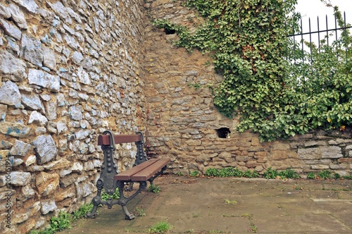 Bench In A Corner Of A Park With Brick Wall Background Retro Style