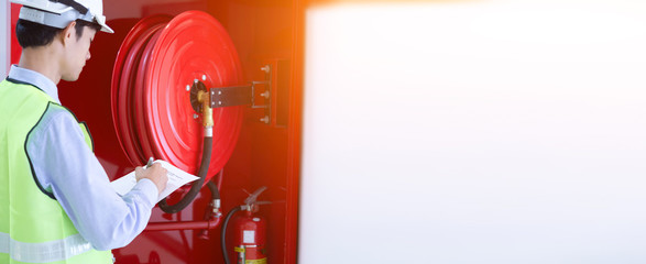 Engineer inspection Fire extinguisher and fire hose.