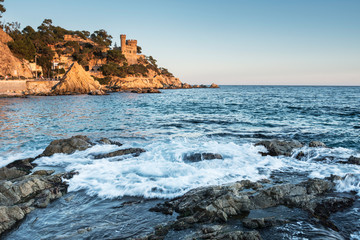Wall Mural - Landscape of Lloret de Mar Castle and its beach in a sunny afternoon, Spain.