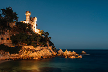 Wall Mural - Landscape of Lloret de Mar Castle and its beach at night