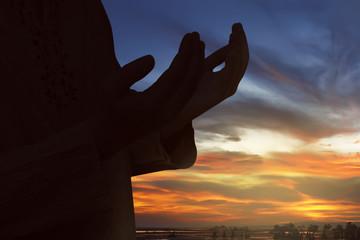 Silhouette of muslim man praying to god