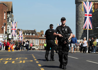 Armed police patrol ahead of the changing of the guard ceremony in Windsor