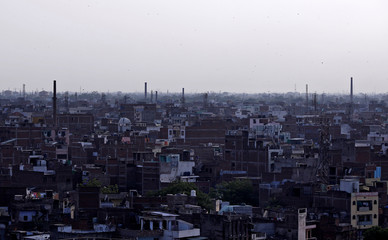 Chimneys of leather tanneries are seen in Kanpur