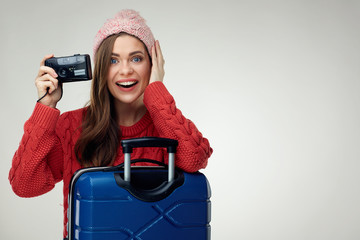 Surprising woman with travel case holding camera.