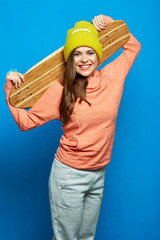 Healthy and beauty girl holding skateboard.