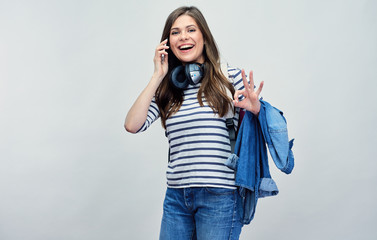 student woman using mobile, cell phone.