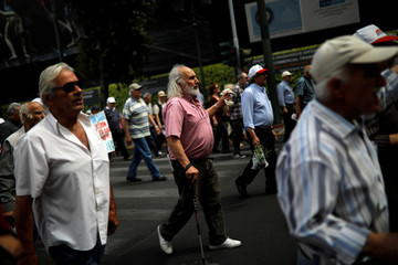 Greek pensioners protest against planned pension reforms in central Athens