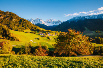 Sunny day in St. Magdalena village. Location place Funes valley, Dolomiti Alps.