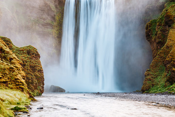 Lovely view of famous Skogafoss waterfall and scenic surroundings. Location place Skoga river, Iceland, Europe.