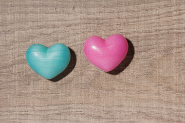 Couple of blue and red heart shapes over wooden table. Valentine day. Background use. Concept of love and romance.