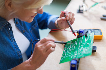 Senior woman in electronics workshop