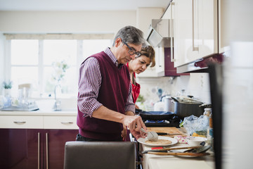 Mature Couple Preparing Chapati Together